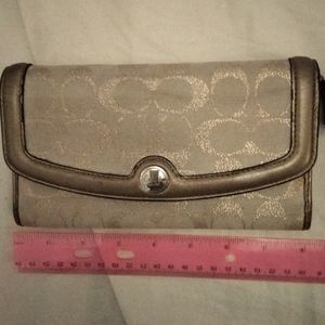 Gently used Coach envelope Wallet in tan/gold